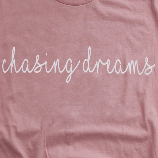 """Rose Bella Canvas brand short sleeve """"Chasing Dreams"""" screen printed boutique graphic tee.  - Pack Breakdown: 6pcs/pack - Sizes: 1S / 2M / 2L / 1XL - 100% Cotton"""