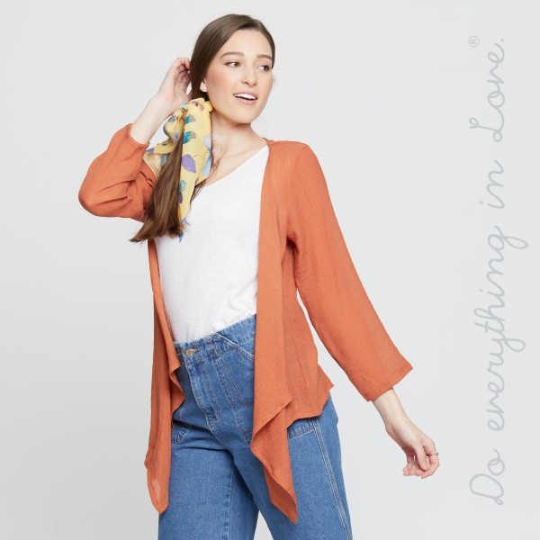 """Do everything in Love brand women's lightweight solid sheer crop kimono with shark bite hem.  - One size fits most 0-14 - Approximately 20"""" L in back  - Front hangs 33"""" L - 100% Polyester"""