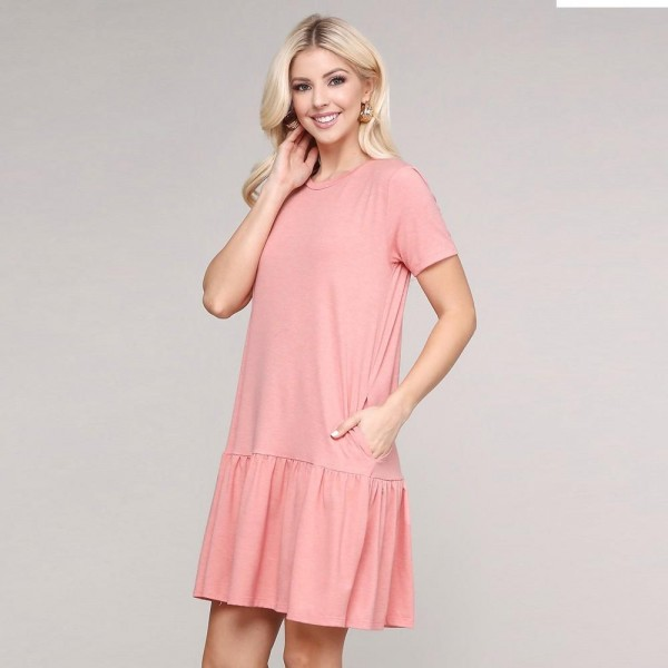 """Women's solid color ruffle hem dress.  • Short sleeves • Crew neckline • Side pockets for keeping your hands warm • Ruffle hemline • Soft and comfortable fabric • Perfect for styling with sandals or heels • Imported  - Pack Breakdown: 6pcs/pack - Sizes: 2-S / 2-M / 2-L - Approximately 34""""L - 62% Polyester, 34% Rayon, 4% Spandex"""