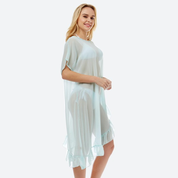 "Women's lightweight solid sheer half ruffle cover up top.  - One size fits most 0-14 - Approximately 38"" L - 100% Polyester"