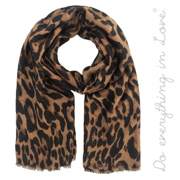 "Do everything in Love brand lightweight leopard print scarf.  - Approximately 34"" W x 70"" L - 100% Polyester"