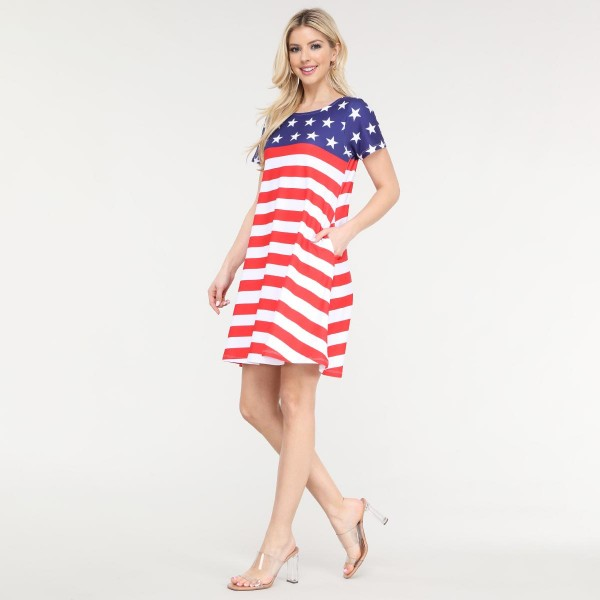 """Women's Short Sleeve American Flag Summer Dress with Pockets.  • Round neckline • Short sleeves • Two pockets to keep your hands warm • A-line silhouette • Soft and comfortable fabrication • Pull on/off design • Imported  - Pack Breakdown: 6pc/pack - Sizes: 2-S / 2-M / 2-L  - Approximately 34"""" L - 95% Polyester / 5% Spandex"""