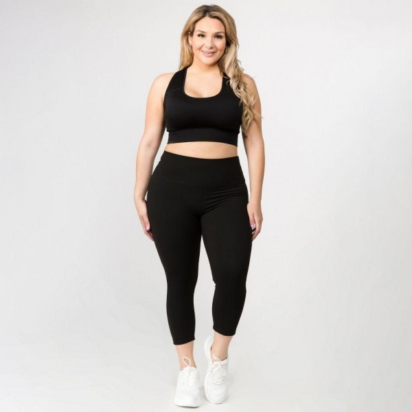 "Women's Plus Size Active Buttery Soft Capri Leggings.  • Wide, high rise waistband lies flat against your skin • Ultra buttery soft fabrication • Interior waistband pocket can hold keys, cards, cash • 4-way stretch for a move-with-you feel • Double inner leg seams for zero bagginess • Moisture wicking • Stretchy and comfortable • Imported  - Pack Breakdown: 6pcs/pack - Sizes: 2-XL / 2-2XL / 2-3XL - Inseam approximately 25"" L - 75% Nylon / 25% Spandex"