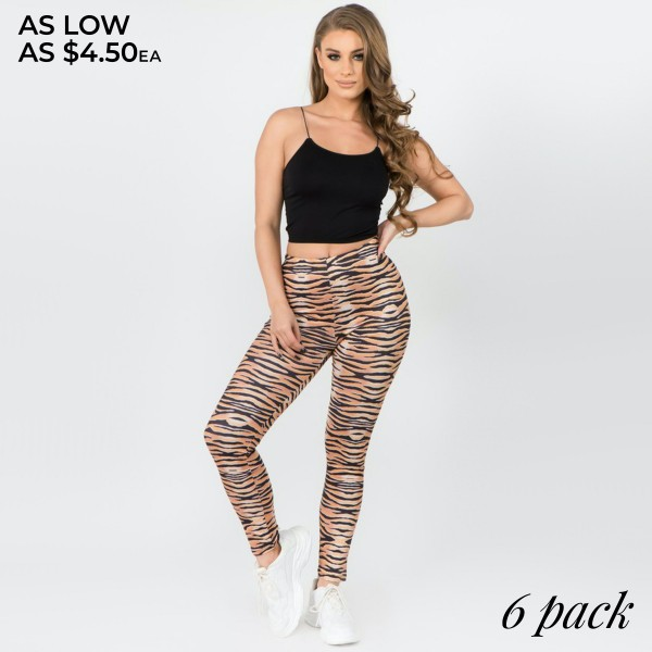 "Women's Active Tiger Print Peach Skin Leggings.  • High rise silhouette • Elasticized waistband • Tiger print • Pull-on styling • Super soft peach skin fabric with stretch • Full length • Fits like a glove • Hand Wash Cold. Do not bleach. Hang Dry • Imported  - Pack Breakdown: 6pcs/pack - Sizes: ONE SIZE Fits most 0-14 - Inseam approximately 28"" L - 95% Polyester / 5% Spandex"