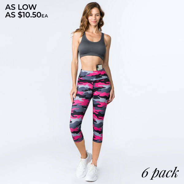 "Women's Active Pink Camouflage Workout Capri Leggings.  • High rise waistband features hidden pocket for phone or other loose items • Pink camouflage print • 4 way stretch for more movement • Capri length design • Fits like a glove • Squat Proof • Flat lock seams prevent chafing • Triangular Cotton Gusset Lining • Moisture wick fabric • Perfect for all low to high impact workouts • Pull on/off styling • Imported  - Pack Breakdown: 6pcs/pack - Sizes: 2-S / 2-M / 2-L  - Inseam approximately 18"" L  - 46% Polyester / 41% Nylon / 13% Spandex"