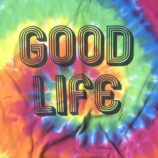 """Good Life"" Printed Tie-Dye Graphic Tee.  - Printed on a ColorTone Brand Tee - Pack Breakdown: 6pcs/pack - Sizes: 1-S / 2-M / 2-L / 1-XL - 100% Cotton"