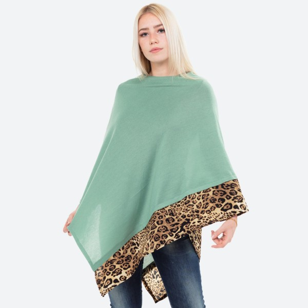 "Women's Lightweight Knit Poncho Featuring Leopard Print Trim Detail.  - One size fits most 0-14 - Approximately 37"" L - 100% Acrylic"