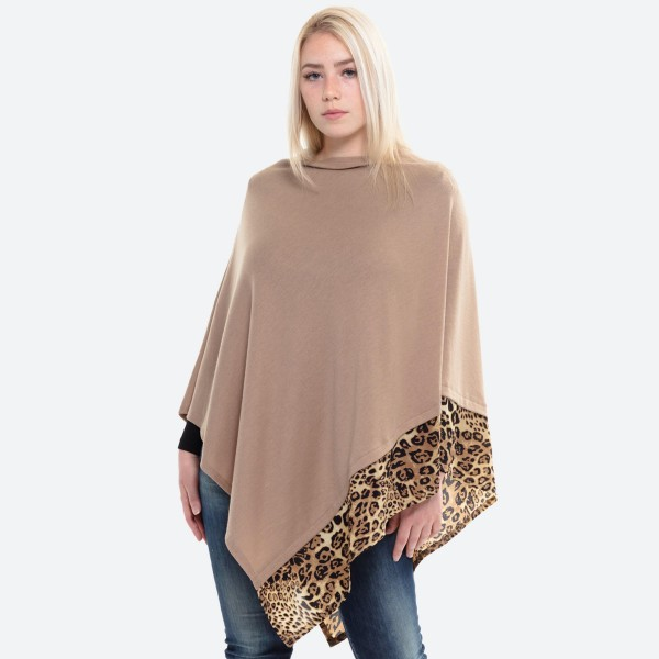 """Women's Lightweight Knit Poncho Featuring Leopard Print Trim Detail.  - One size fits most 0-14 - Approximately 37"""" L - 100% Acrylic"""