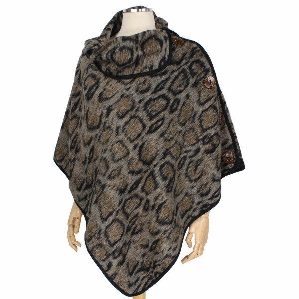 "Animal Print Coconut Button Poncho.  - One size fits most  - Approximately 34"" L  - 100% Polyester"