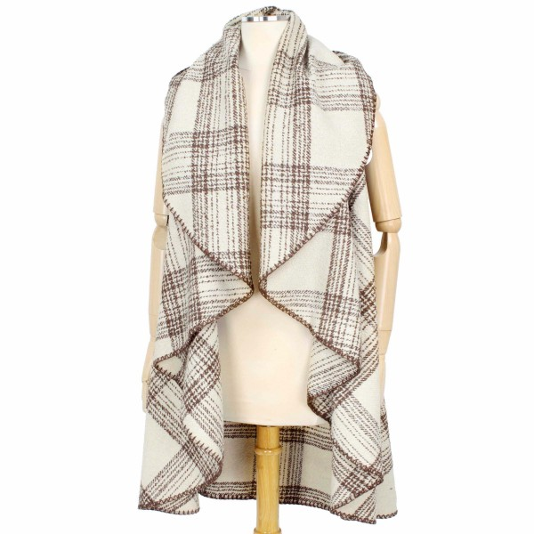 Rounded Plaid Vest Featuring Pockets.  - One size fits most 0-14 - 100% Polyester