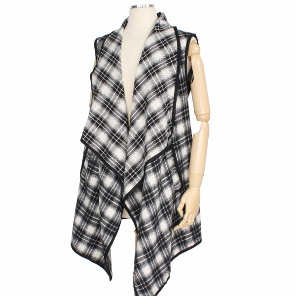 """Fall/Winter Plaid Vest Featuring Pockets.  - One size fits most 0-14 - Approximately 33"""" L  - 100% Polyester"""