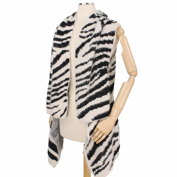 Furry Zebra Print Knit Vest.  - One size fits most 0-14 - 50% Polyester / 50% Acrylic