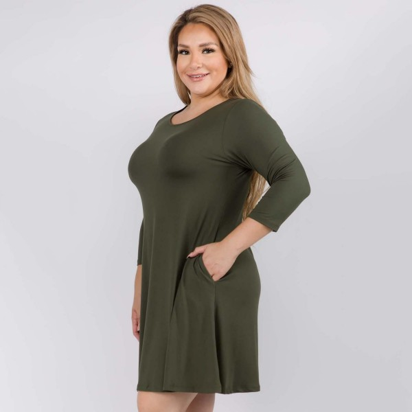 """Women's Plus Size Solid 3/4 Sleeve Swing Dress Featuring Side Pockets.  • Relax Scoop Neckline • ¾ Fitted Sleeves • Front Pleats • Swing Style Bodice • Solid Color • Closure Style: Pullover • Hand Wash Cold/Tumble Dry/Iron Low/Do not Dry Clean • Import  - Pack Breakdown: 6 Dresses Per Pack - Sizes: 2-XL / 2-2XL / 2-3XL - Approximately 34"""" L - 95% Polyester / 5% Spandex"""