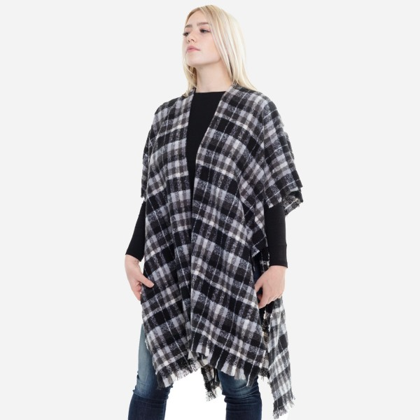 "Women's Plaid Print Short Sleeve Kimono.  - One size fits most 0-14 - Approximately 37"" L  - 100% Acrylic"
