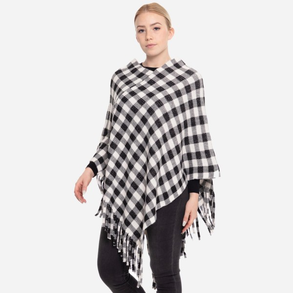 """Buffalo Check Winter Poncho Featuring Tassel Trim.  - One size fits most 0-14 - Approximately 37"""" L  - 100% Acrylic"""