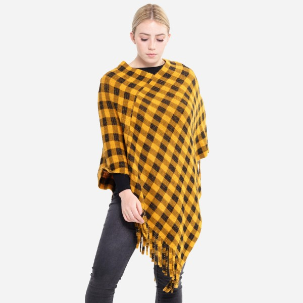 "Buffalo Check Winter Poncho Featuring Tassel Trim.  - One size fits most 0-14 - Approximately 37"" L  - 100% Acrylic"