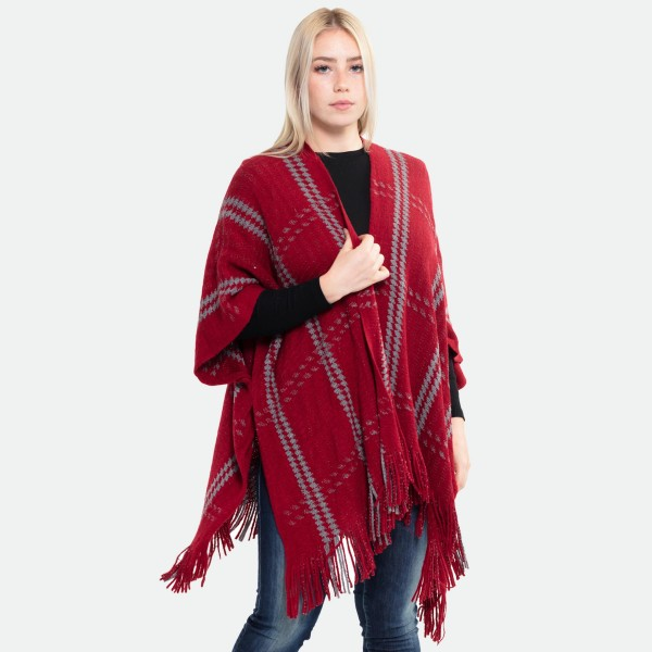 "Houndstooth Knit Plaid Winter Ruana Featuring Tassel Trim.  - One size fits most 0-14 - Approximately 32"" L  - 100% Acrylic"