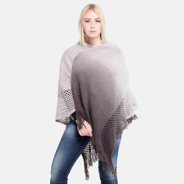 "Women's Ombre Waffle Knit Poncho Featuring Fringe Tassels.  - One size fits most 0-14 - Approximately 35"" L  - 100% Acrylic"