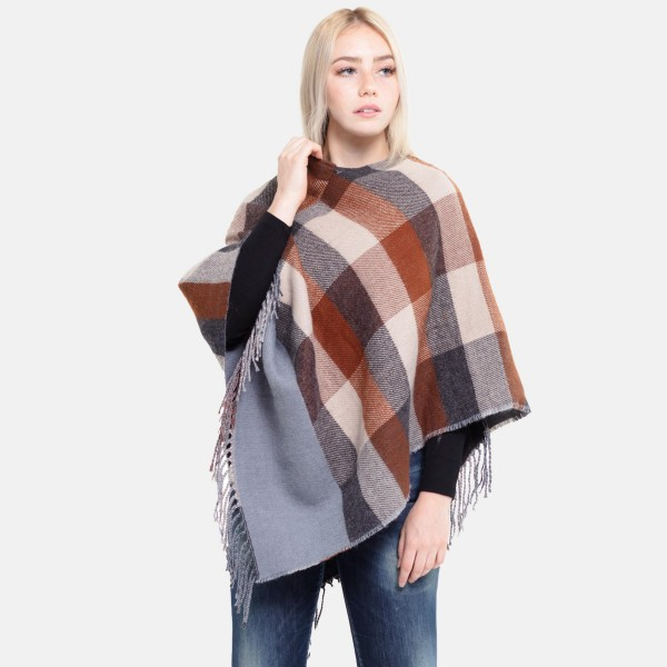 "Women's Colorblock Knit Poncho Featuring Fringe Tassels.  - One size fits most 0-14 - Approximately 35"" L - 100% Polyester"