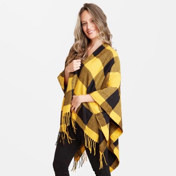 "Women's Fall/Winter Buffalo Check Shawl Featuring Fringe Tassel Trim.  - One size fits 0-14 - Approximately 35"" L  - 100% Acrylic"