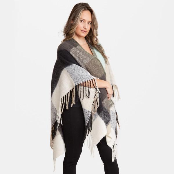 "Women's Oversized Fleece Plaid Ruana Featuring Fringe Tassels Trim.  - One size fits most 0-14 - Approximately 33"" L  - 100% Acrylic"