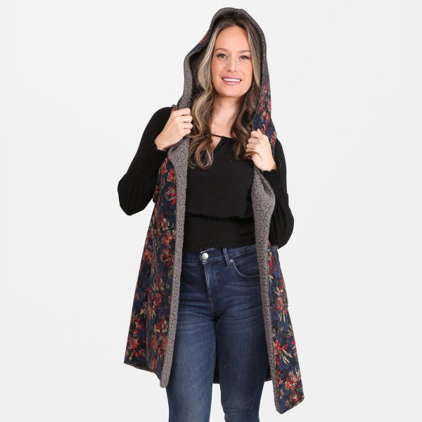 """Floral Print Hooded Sherpa Vest Featuring Pockets.  - One size fits most 0-14 - Approximately 37"""" L - 100% Acrylic"""