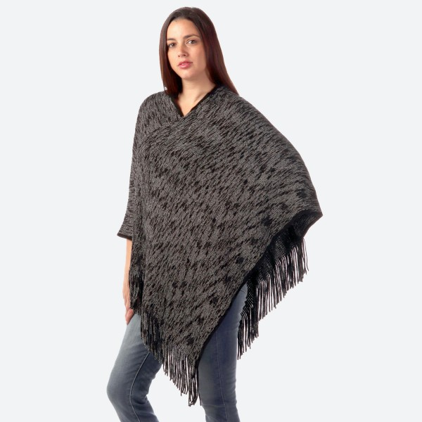 "Women's Marled Knit Poncho Featuring Fringe Tassels.  - One size fits most 0-14 - Approximately 36"" L  - 80% Acrylic / 20% Polyester"