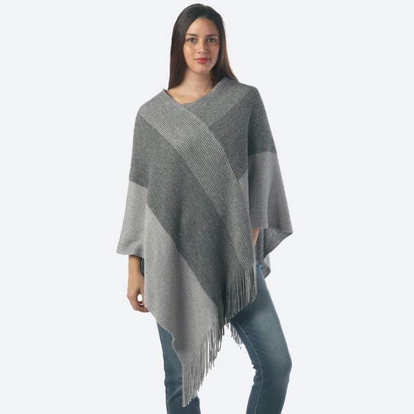 "Women's Wide Stripe Knit Poncho with Fringes Featuring Metallic Accents.  - One size fits most 0-14 - Approximately 40"" Long - 80% Acrylic / 20% Polyester"