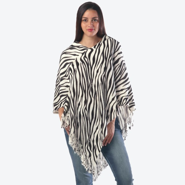 "Women's Zebra Print Knit Poncho Featuring Fringe Tassel Trim.  - One size fits most 0-14 - Approximately 36"" Long -100% Acrylic"