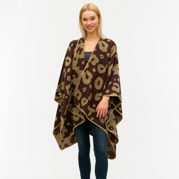 """Women's Reversible Leopard Print Ruana/Wrap.  - One size fits most 0-14 - Approximately 32"""" Long  - 100% Polyester"""