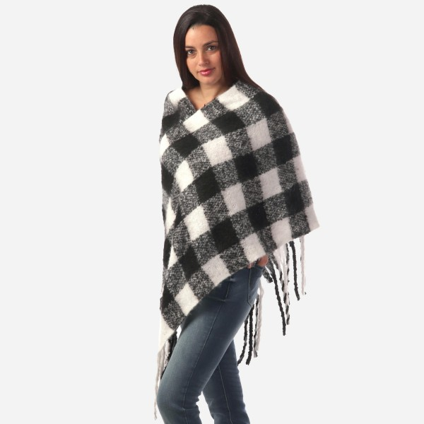 "Women's Fleece Buffalo Check Poncho Featuring Fringe Tassels.  - One size fits most 0-14 - Approximately 40"" Long  - 100% Polyester"