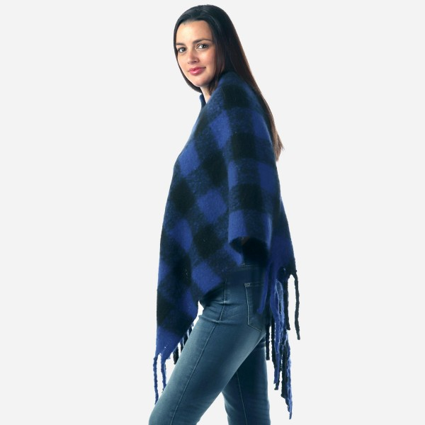 """Women's Fleece Buffalo Check Poncho Featuring Fringe Tassels.  - One size fits most 0-14 - Approximately 40"""" Long  - 100% Polyester"""