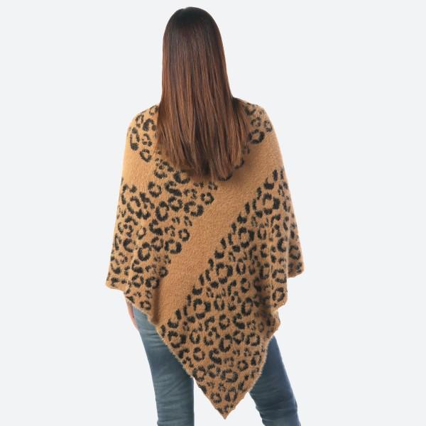 "Women's Leopard Print Knit Stripe Poncho.  - One size fits most 0-14 - Approximately 33"" Long  - 100% Acrylic"