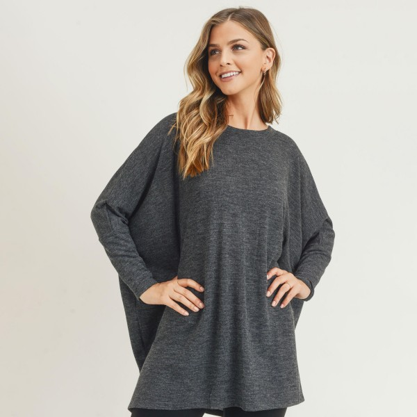 Women's Oversized Dolman Sleeve Tunic Top. (6 PACK)  • Round neckline • Dropped shoulder seam detail • Dolman long sleeves • Soft and comfortable fabric with stretch • Oversized silhouette • Perfect for styling with leggings or skinny jeans • Imported  - Pack Breakdown: 6 Shirts Per Pack - Sizes: 2-S / 2-M / 2-L - 80% Polyester, 16% Cotton, 4% Spandex