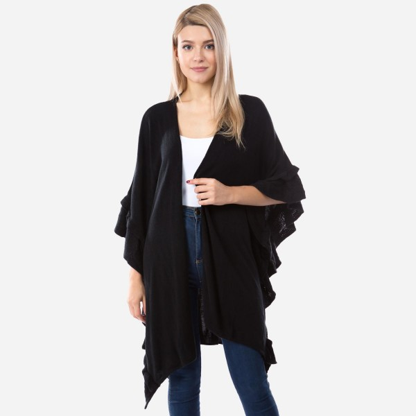 "Women's Solid Knit Ruffle Trim Kimono.  - One size fits most 0-14 - Approximately 33"" L  - 100% Acrylic"