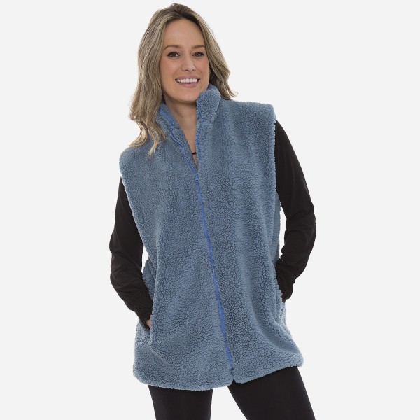"Women's Sherpa Vest Featuring Pockets.  - Front Zipper Closure - Front Pockets - One size fits most 0-14 - Approximately 30"" L - 100% Polyester"