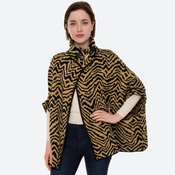 "Women's Zebra Print Knit Poncho Sweater.  - One size fits most 0-14 - Approximately 30"" L - 100% Acrylic"