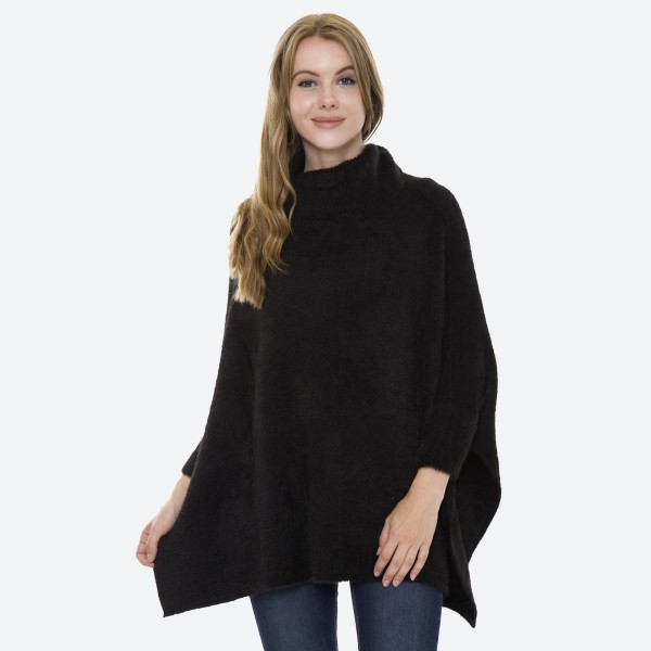 Women's Fuzzy Knit Turtleneck Batwing Sleeve Sweater Featuring Side Slit Details.  - Side Slit Details - Batwing Style Sleeves - Soft Fuzzy Knit Material  - One size fits most 0-14 - 100% Acrylic