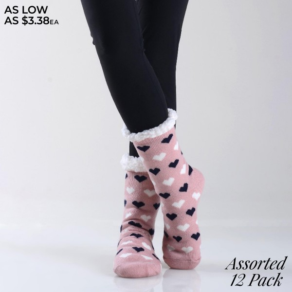Women's Assorted Heart Knit Sherpa Socks. (12 Pack)  • Unique, pattern designs on exterior • Reinforced toe seam • Thick • Breathable • Rubber dot traction bottom • Plush faux sherpa lining • Imported  - 12 Pair Per Pack - 6 Assorted Colors - Size: Adult 9-11 - 40% Acrylic, 60% Polyester