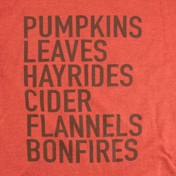 """Pumpkins, Leaves, Hayrides, Flannels & Bonfires"" Graphic Tee. (MEDIUM ONLY)  - Printed on a Gildan Heavy Cotton Brand Tee - Color: Heather Burnt Orange  - 90% Cotton / 10% Polyester"