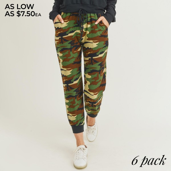 "Women's High Rise Camouflage Joggers. (6 Pack)  • High rise drawstring waistband • Two side pockets for keeping your hands warm • Camouflage print • Banded cuffs • Relaxed fit • Soft and comfortable • Stretchy fabrication • Pull on/off design • Style with your favorite tee for a laid-back look • Comfortable for lounging at home • Imported  - 6 Pair Per Pack - Sizes: 2-S / 2-M / 2-L  - Inseam approximately 28"" L - 95% Polyester / 5% Spandex"
