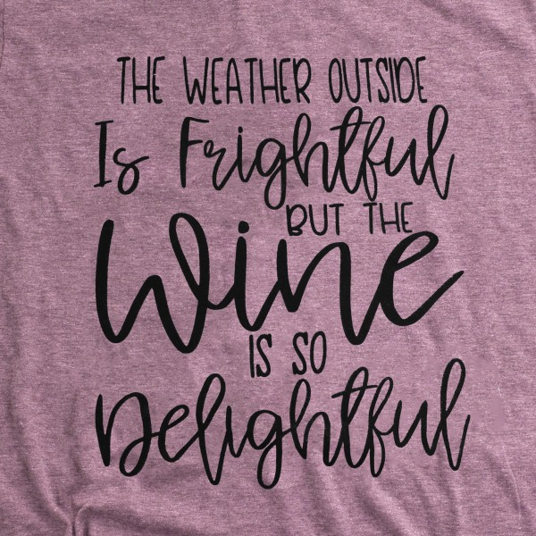 """The Weather Outside is Frightful but the Wine is So Delightful"" Christmas Graphic Tee.  - Printed on a Gildan Softstyle Brand Tee - Color: Maroon - 6 Shirts Per Pack - Sizes: 1-S / 2-M / 2-L / 1-XL - 65% Polyester / 35% Cotton"