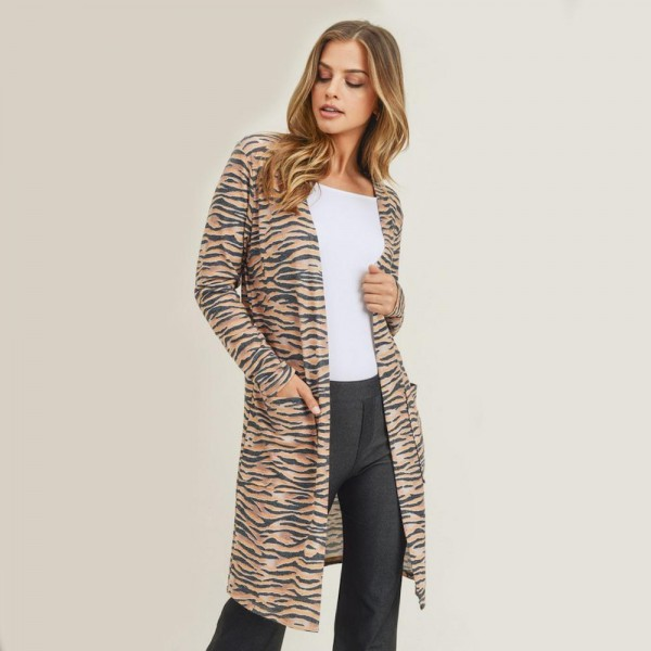 """Women's Lightweight Zebra Stripe Duster Cardigan. (6 Pack)   • Long sleeves • Open front design • Two stylish side pockets • Zebra striped print • Soft and comfortable • Duster length hem • Long length hem • Imported  - 6 Cardigans Per Pack - Sizes: 2-S / 2-M / 2-L  - Approximately 34"""" Long - 80% Polyester / 16% Cotton / 4%Spandex"""