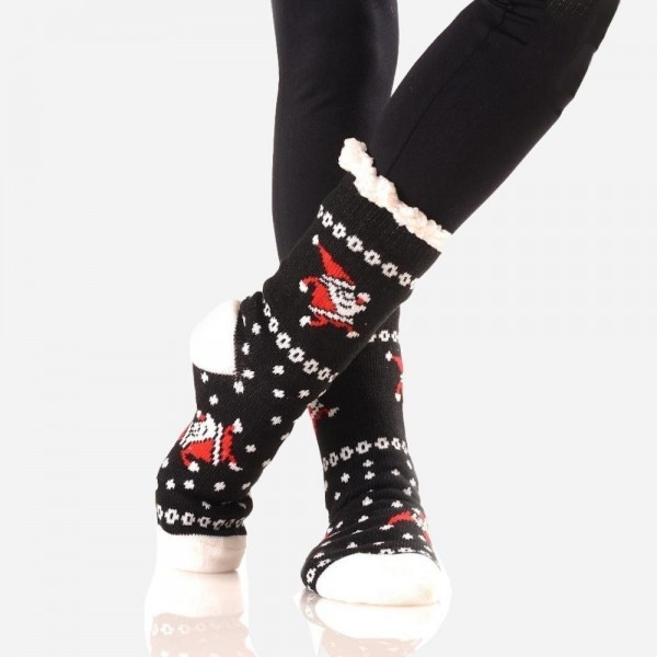 Women's Christmas Print Sherpa Socks.  • Unique, pattern designs on exterior • Reinforced toe seam • Thick • Breathable • Rubber dot traction bottom • Plush faux sherpa lining • Imported  - 1 Pair  - Size: Adult 9-11 - 40% Acrylic, 60% Polyester