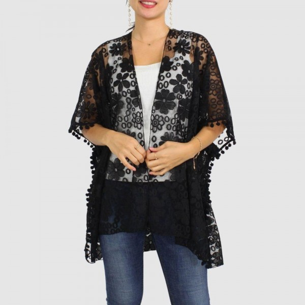 "Women's Floral Lace Kimono Featuring Pom Pom Trim Detail.  - One size fits most0-14 - Approximately 29.5"" in Length - 100% Polyester"