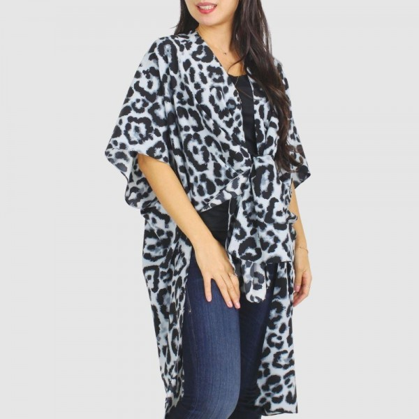 "Women's Leopard Print Kimono.  - One size fits most 0-14 - Approximately 35.5"" in Length - 100% Polyester"