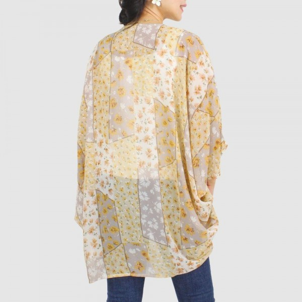 "Women's Lightweight Flower Mix Print Kimono.  - One size fits most 0-14 - Approximately 35"" in Length - 100% Polyester"