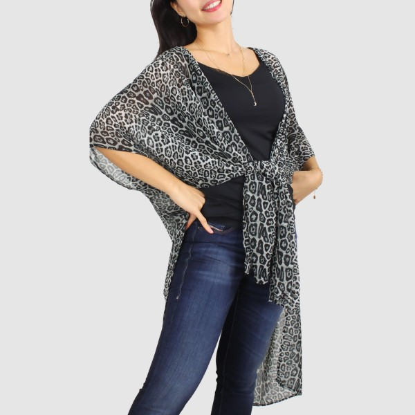"Women's Lightweight Leopard Print Kimono.  - One size fits most 0-14 - Approximately 37"" L - 100% Polyester"
