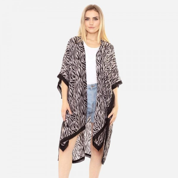 "Women's Lightweight Tiger Stripe Kimono.  - One size fits most 0-14 - Approximately 37"" in Length - 100% Polyester"