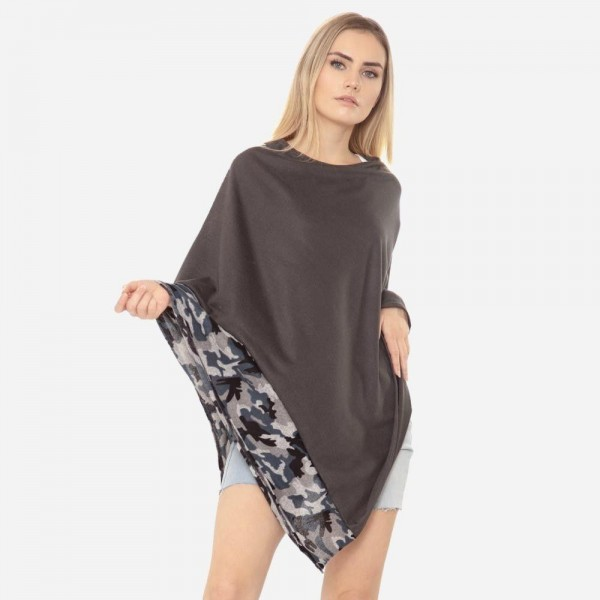 """Women's Lightweight Poncho Featuring Camouflage Trim.  - One size fits most 0-14 - Approximately 37"""" in Length  - 95% Polyester / 5% Spandex"""